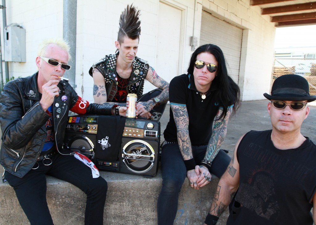 RADIO BRATS: Hailing from Austin, Texas, the Lower Class Brats are, left to right, singer Bones, drummer Joey TK, guitarist Marty Volume and bassist EVO. Bones and Volume have rallied the Brats for 15 bruising years. (Photo by Larry Stern)