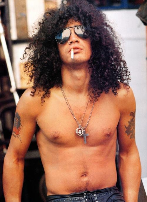 SMOKE MY CIGARETTE WITH STYLE: After decades of huffing cigarettes, Slash finally gave up the filthy habit of wearing shirts.