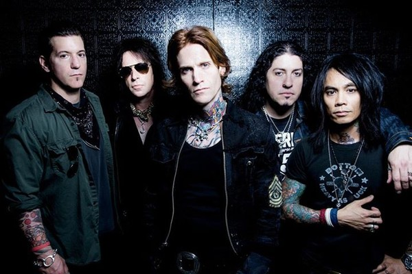 Odd Man Out: Jimmy wearing shades with his former Buckcherry mates.
