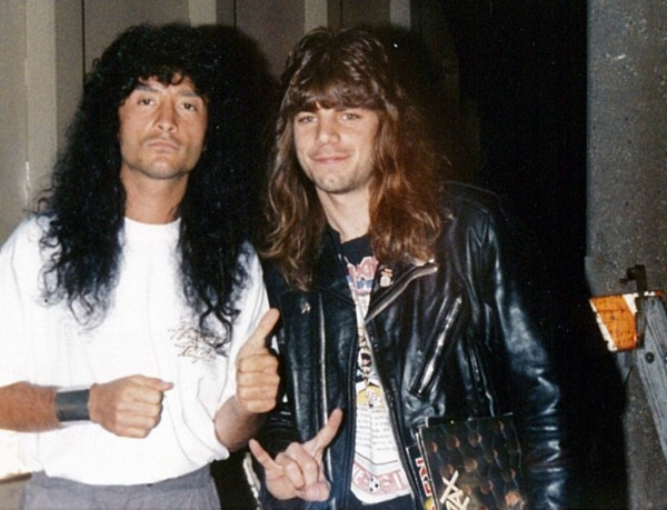BREAKING THE LAW?: Moments after I got this picture taken with Anthrax singer Joey Belladonna, I was escorted off the premises by an all-too-familiar cop. Yeah, it was worth it.