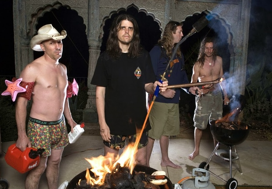 """OUT THERE: As if there was any doubt that Tool has a fun side, Maynard James Keenan, Adam Jones, Danny Carey and Justin Chancellor invite you to party """"Deliverance""""-style with blowtorches, gasoline and kiddie-pool floaties. Enjoy!"""